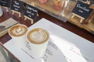 coffee and cakes on shop counter